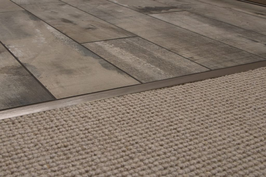 Transition strip between laminate flooring and carpet.