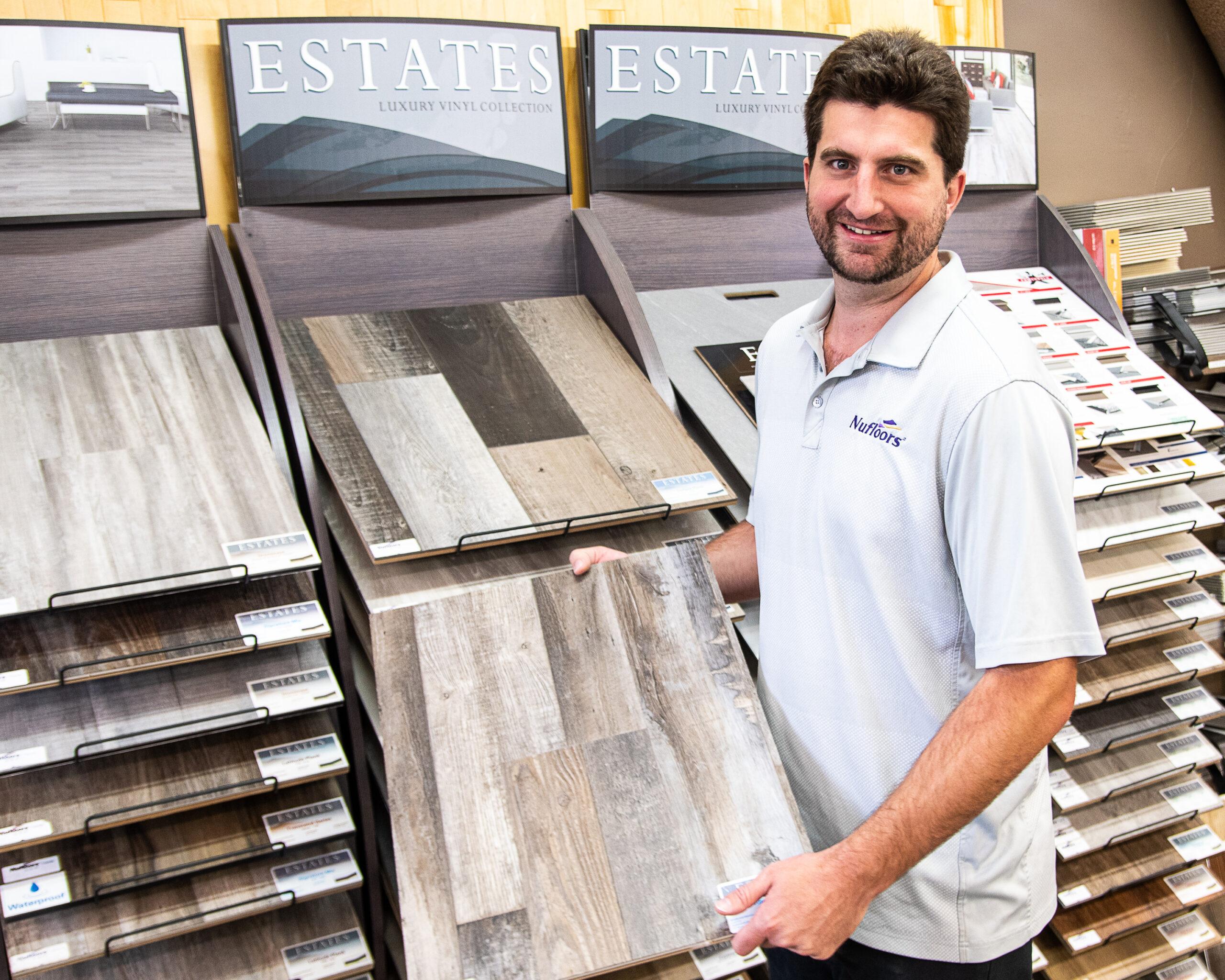 Nufloors Fernie Team Member Showing off Flooring Samples