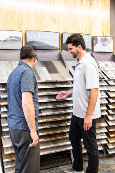 Nufloors Fernie Team Member With Flooring Samples