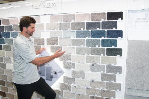 Nufloors Fernie Team Member Displaying Shaw Floors Carpet Samples