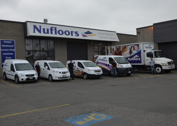 Nufloors Langley Exterior with Branded Vans out front