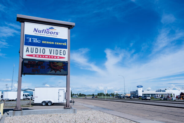 Nufloors Camrose Store Exterior Road Sign