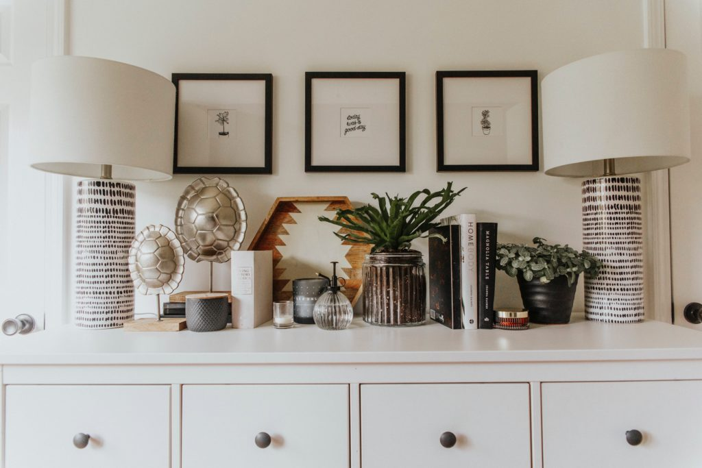 decor items perfectly curated on white dresser